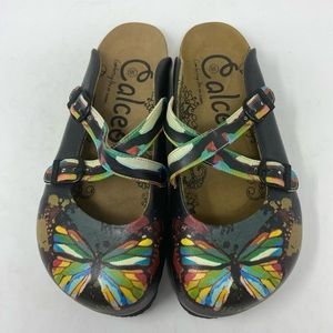 CALCEO Chocolate Brown Butterfly Buckle Clogs